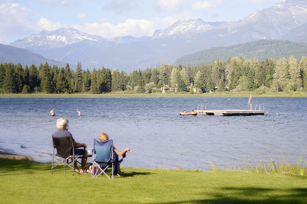 seniors sitting out by the lake