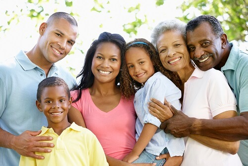 happy multi-generational African American family with estate plan after a family meeting