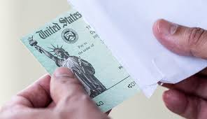 Image of hand opening stimulus check - Can a Nursing Home Take My Stimulus Check?